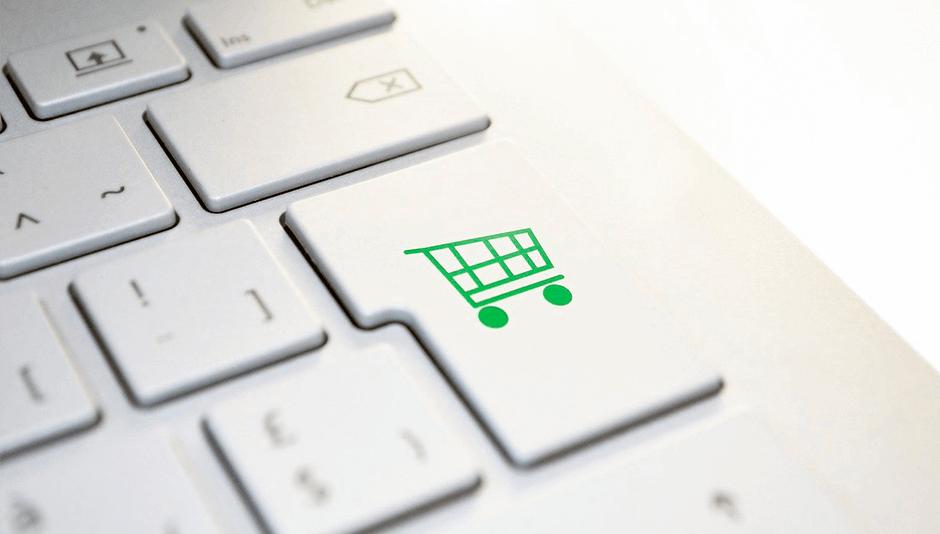 teclado de computadora con símbolo de compra